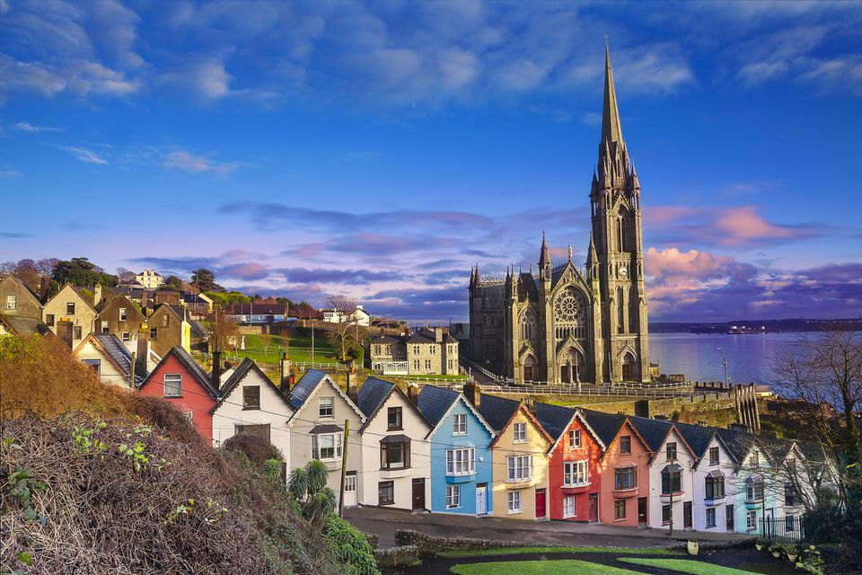 Colorful houses in a row in front of the Cobh cathedral in Ireland