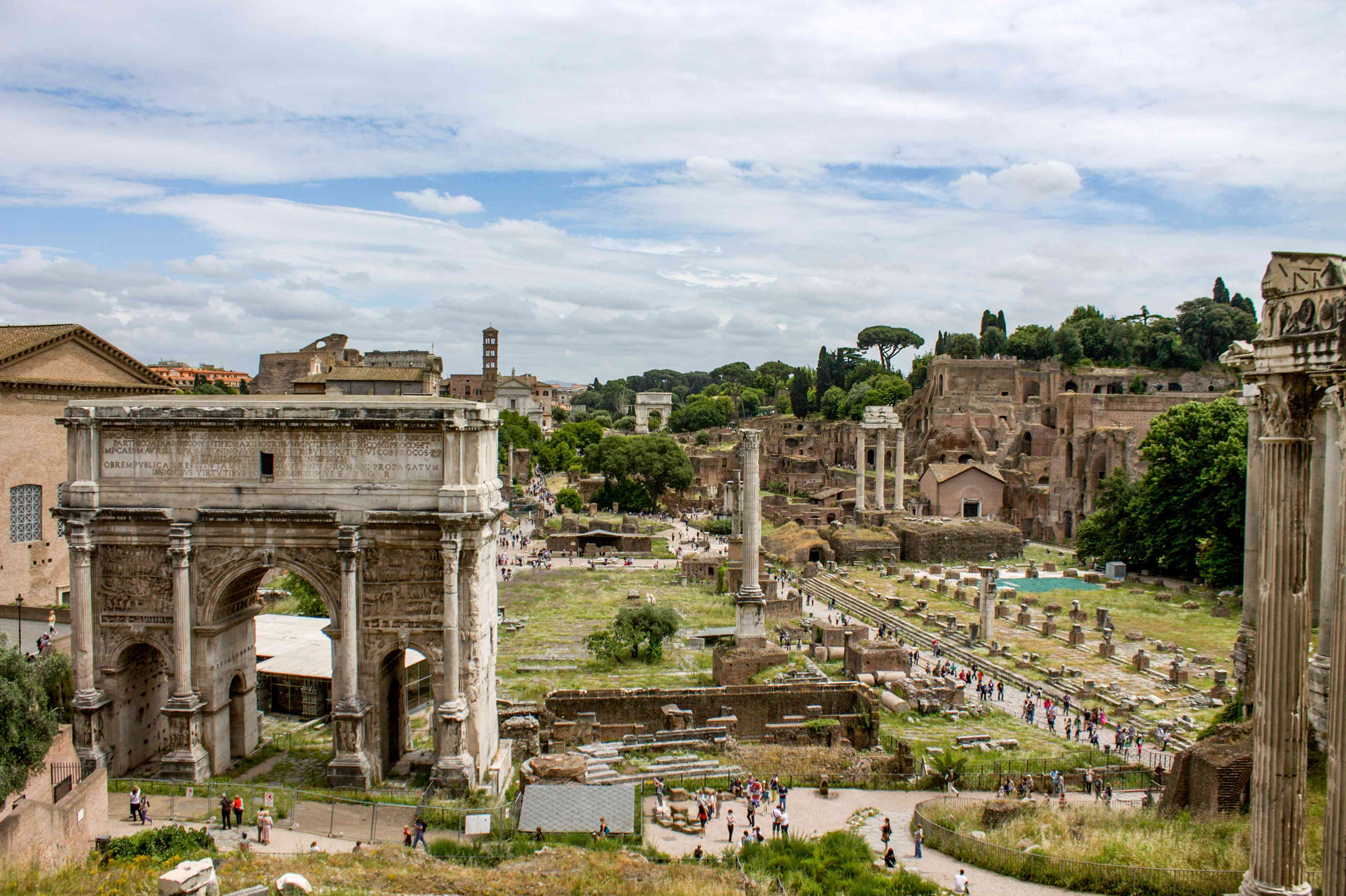 Looking down on a walkway through Palatine Hill seeing ancient roman ruins