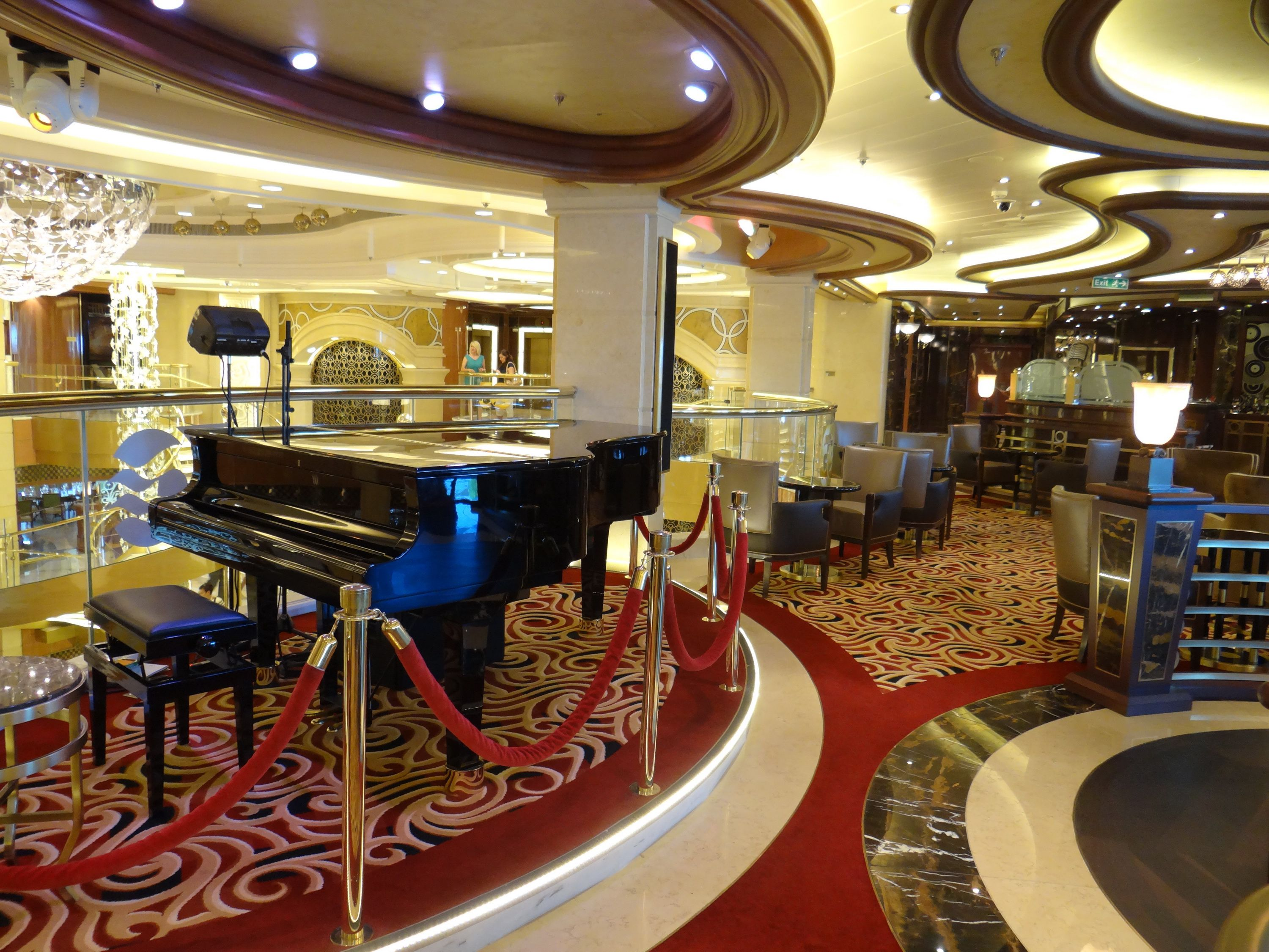 The piano and lounge seating of Crooners Bar on the Regal Princess