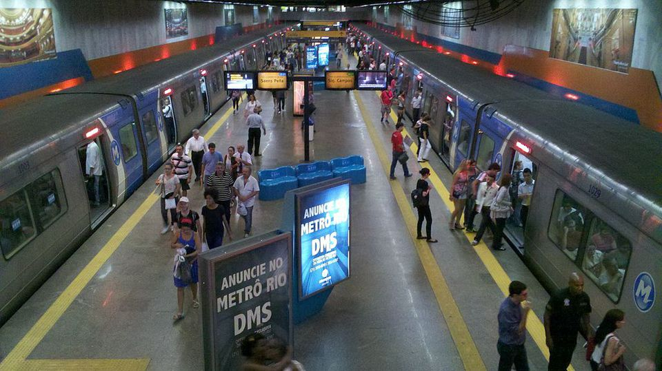 A shot from above of people on a subway platform in Rio