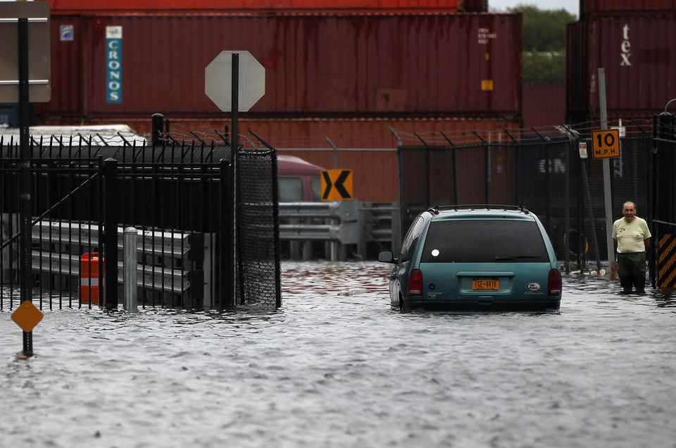 A person walks through a flooded street after Hurricane Irene on August 28, 2011 in the Red Hook neighborhood of the Brooklyn