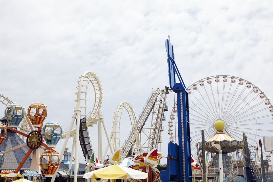 View of amusement park with rollercoaster and ferris wheel
