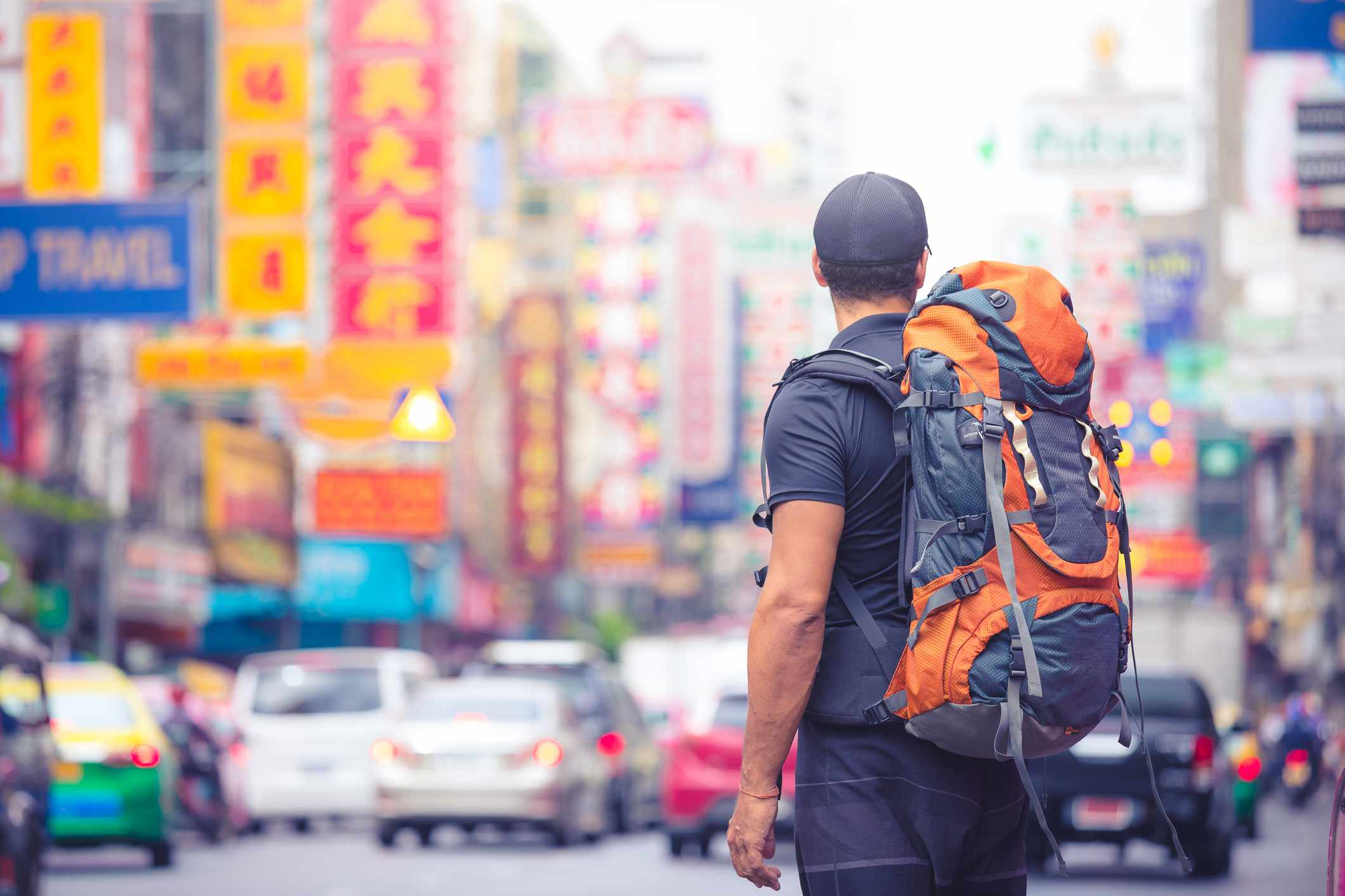 Tourist backpacker visiting a city in southeast Asia