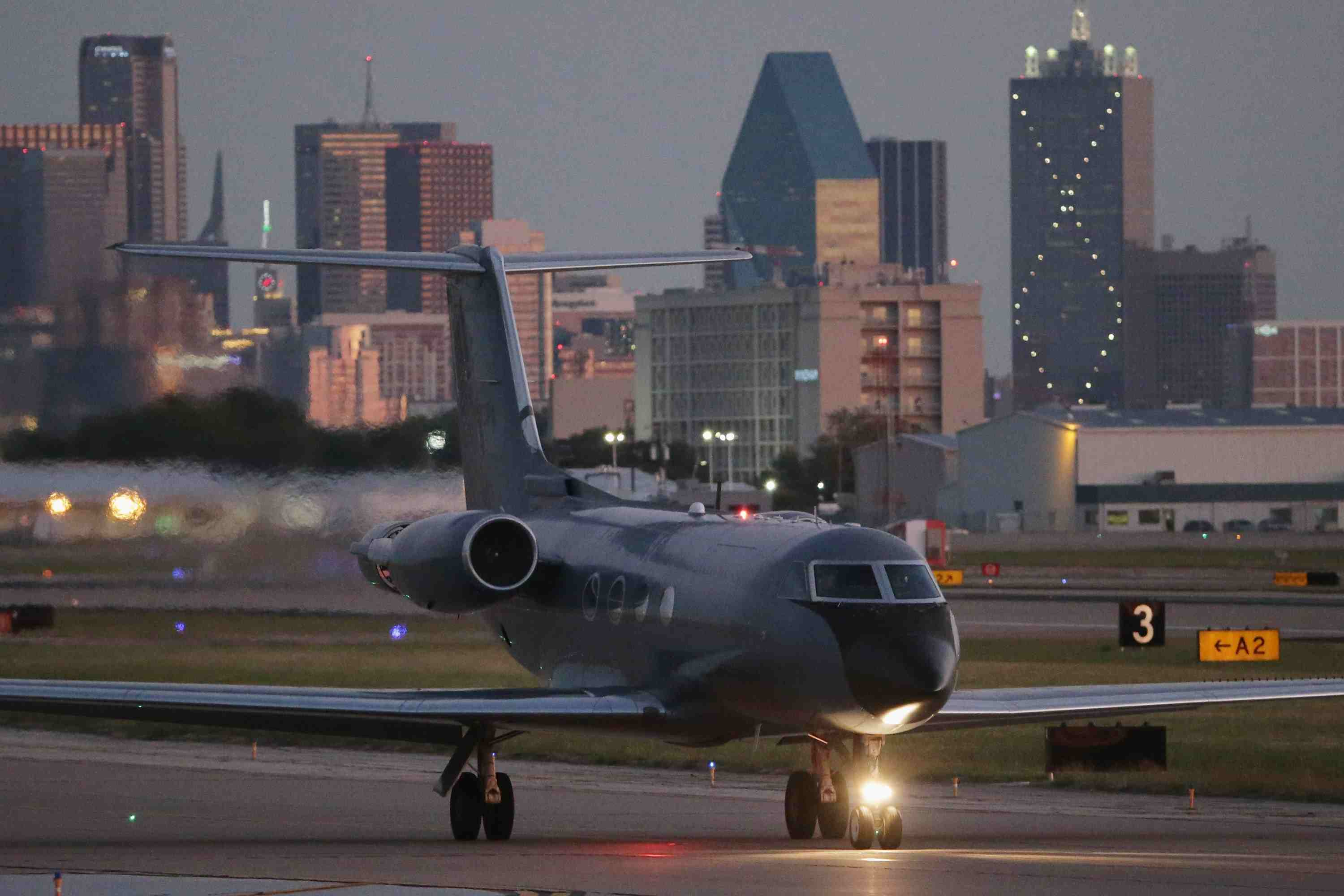 A private plane taxis on the runway at Dallas Love Field