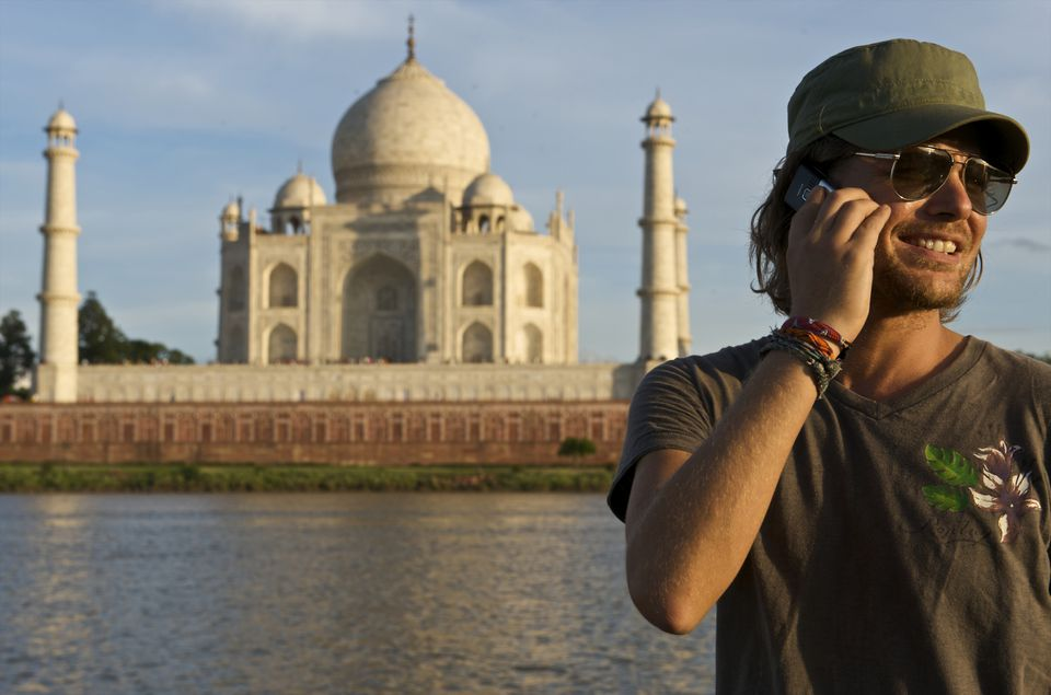 Tourist talking on phone in India.