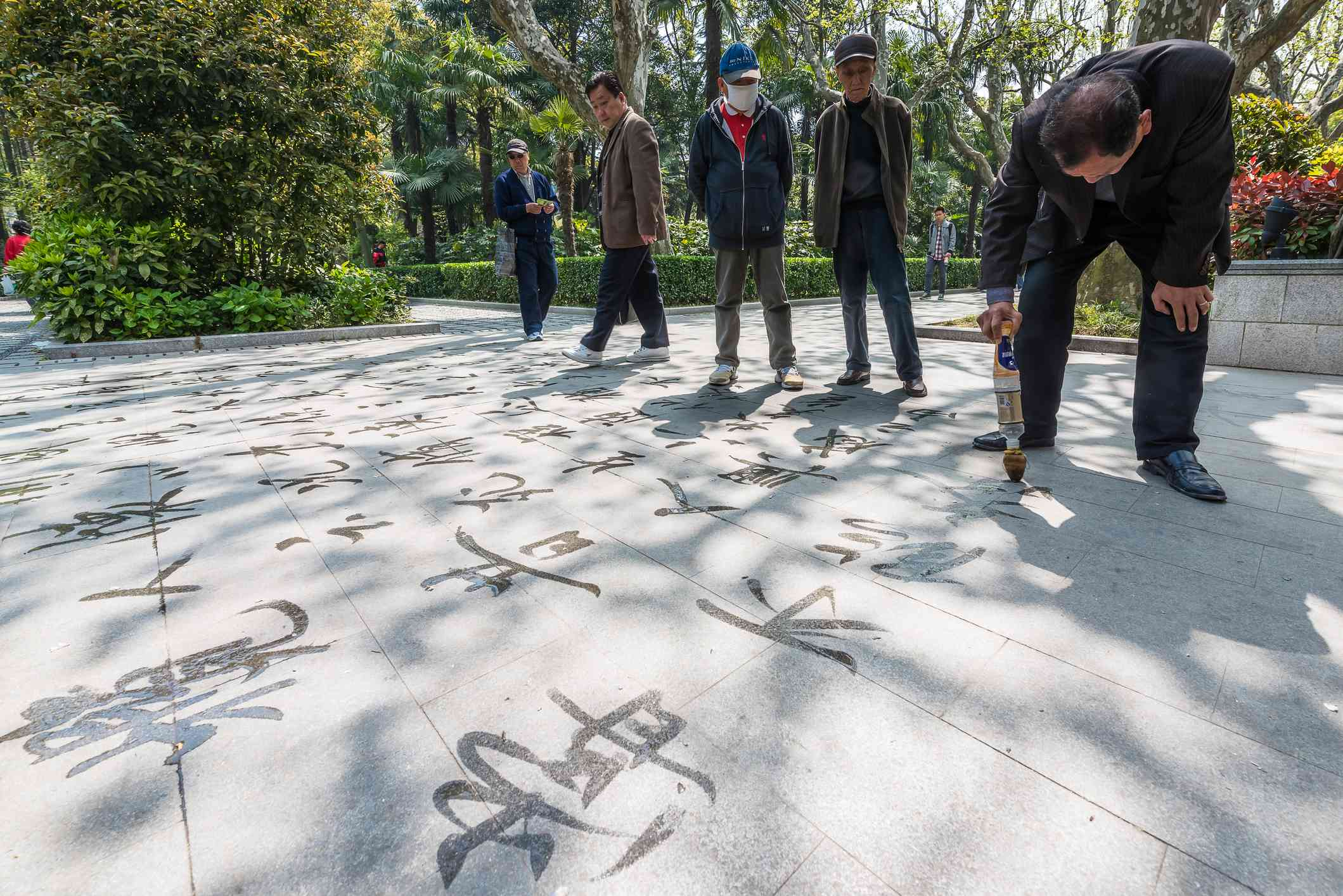 chinese calligraphy with water fuxing park shanghai china