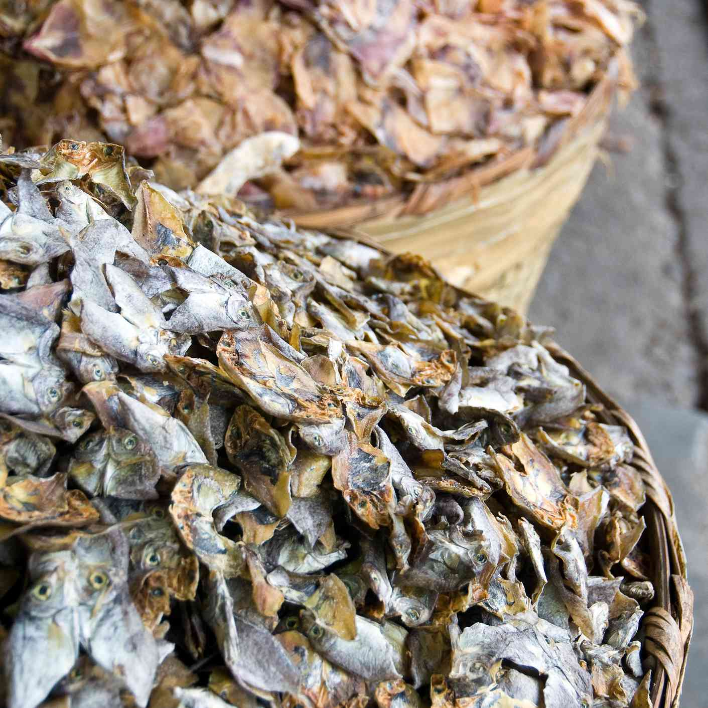 two large containers of dried fish in Cebu
