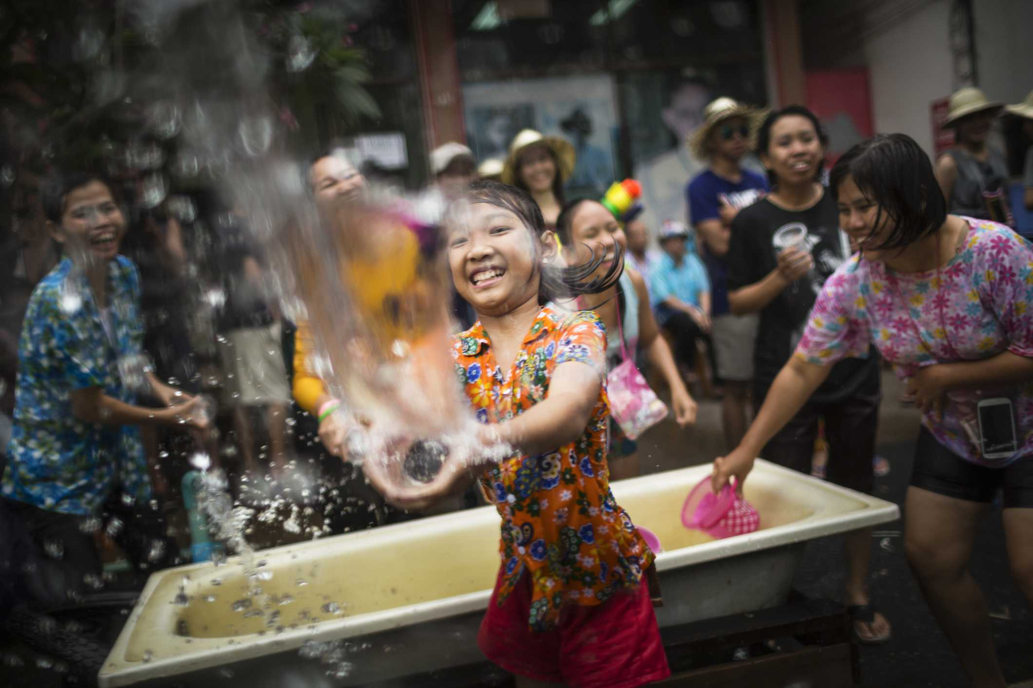 A young girl throws water during Songkran