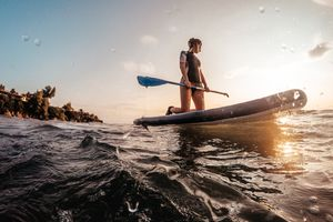Young woman on a paddle board