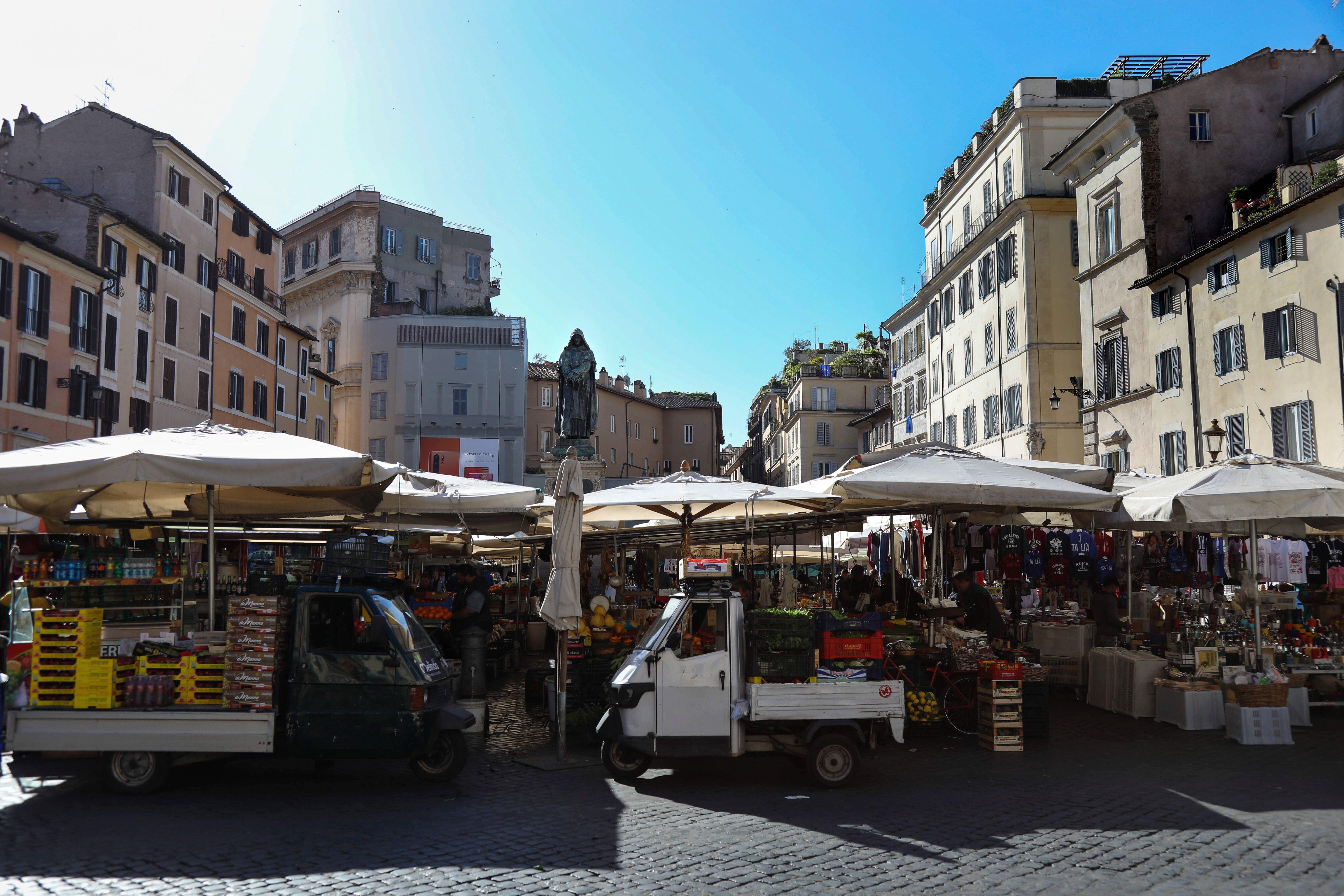 a farmers market in a public square in Rome