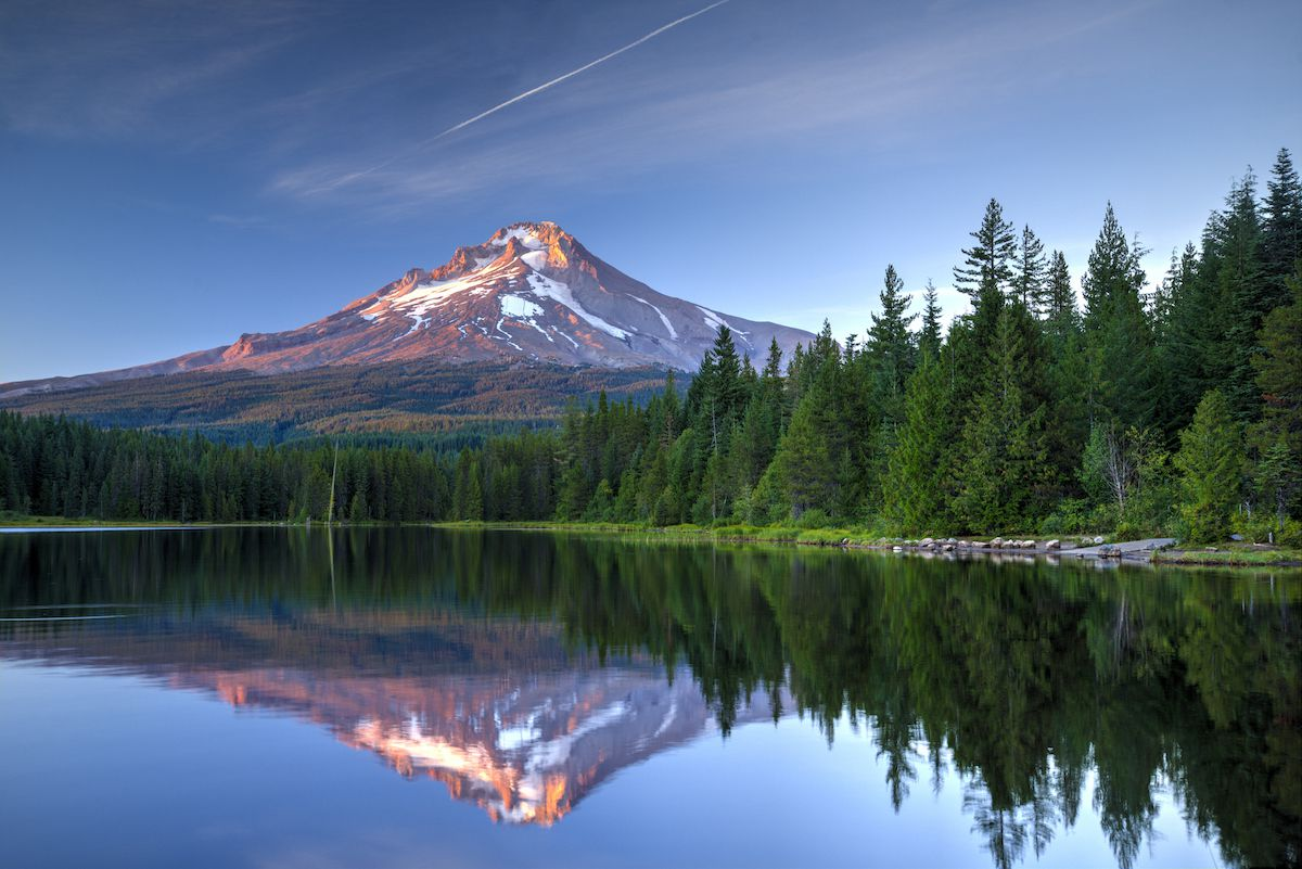 Snowcapped Mt. Hood is reflected on a serene lake