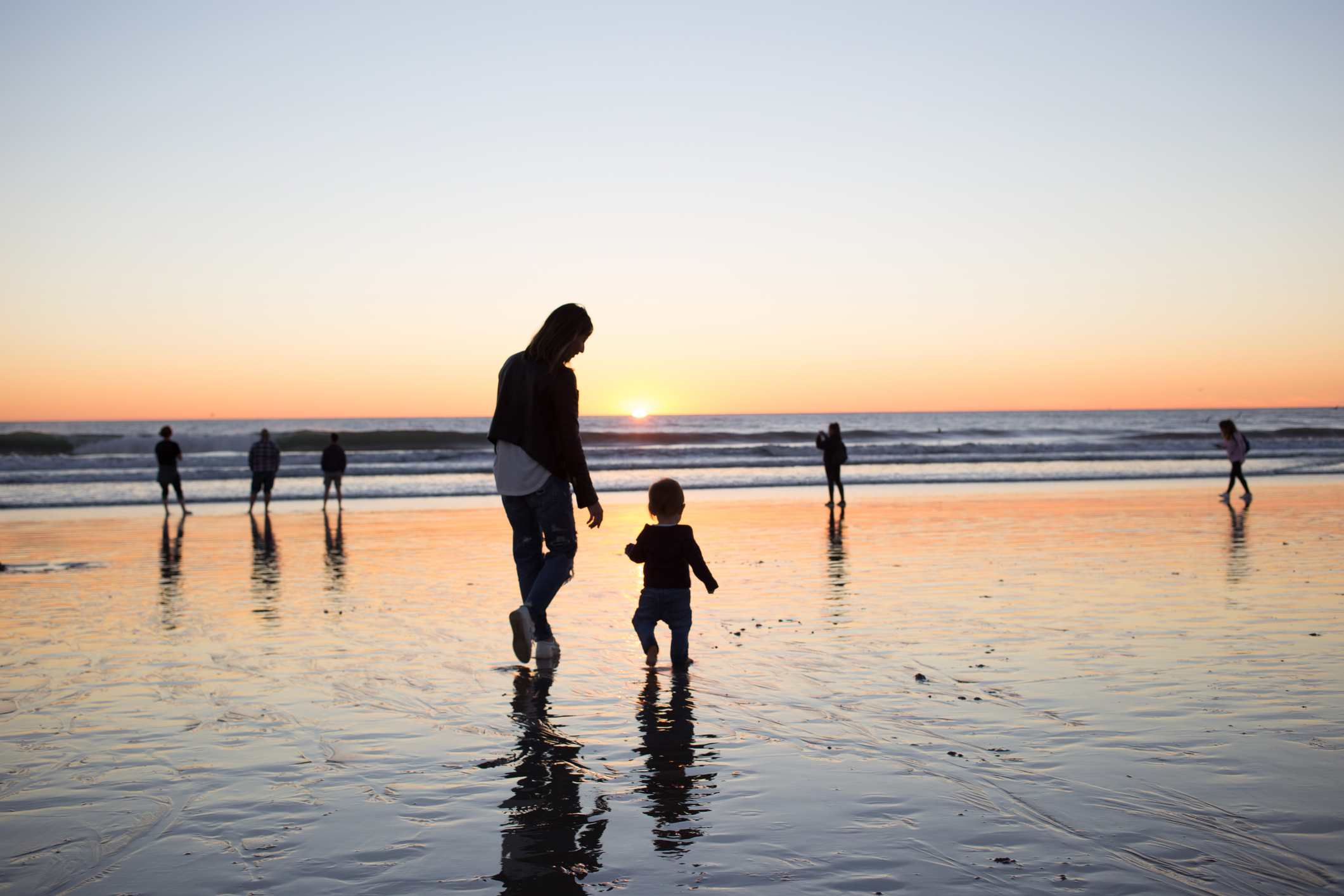 Mother And Child At Venice Beach During The Sunset