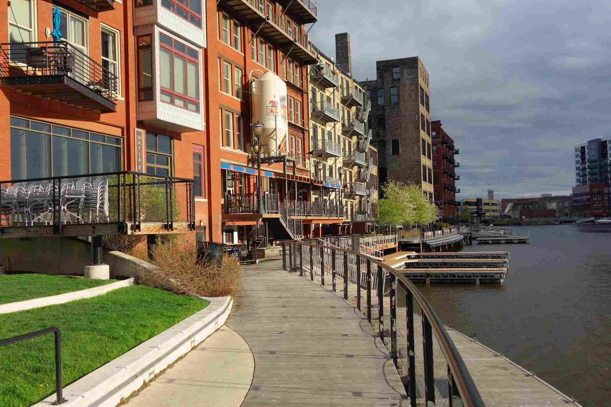 Comp Save to Board The Milwaukee Riverwalk winds through Historic Third Ward