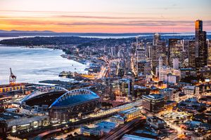 Aerial view of Seattle downtown and harbor at dusk, USA
