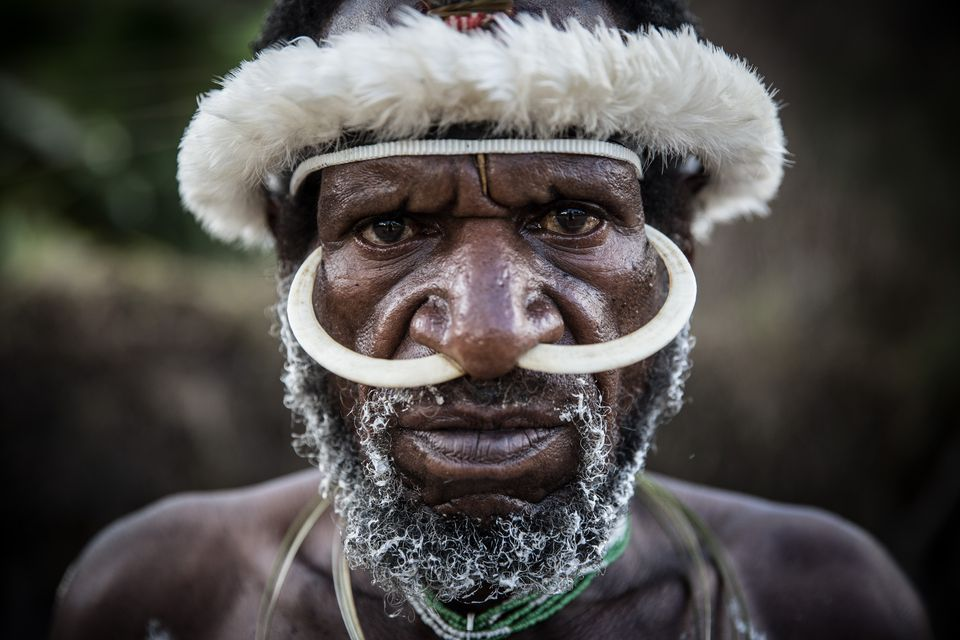 A Papuan man in traditional garb.