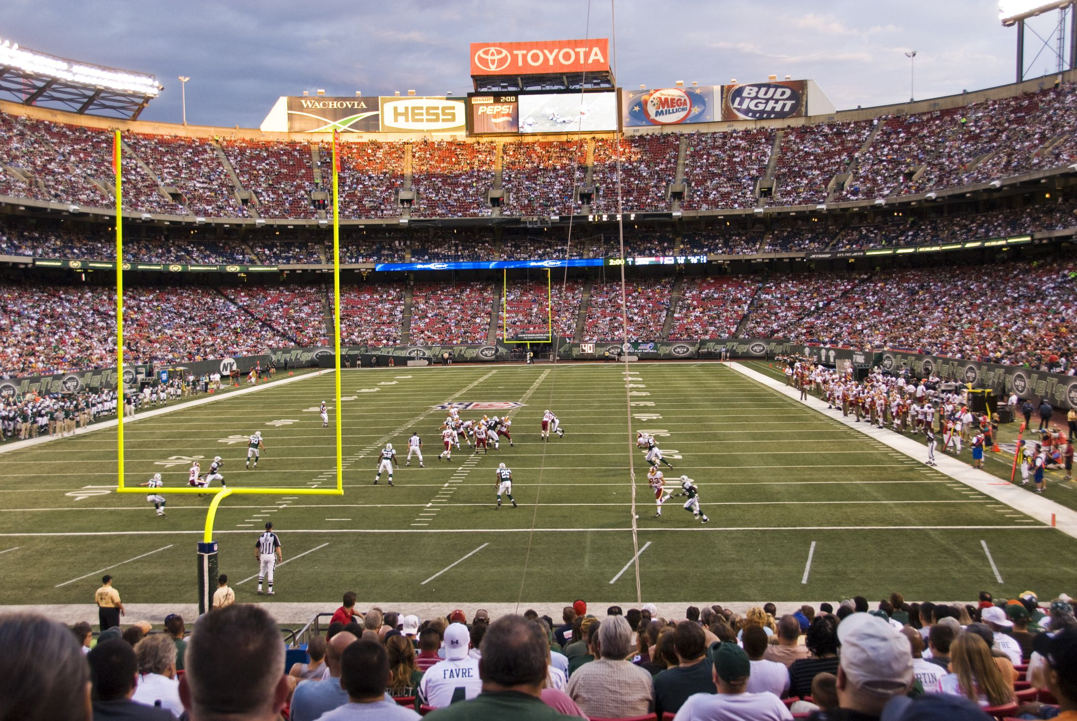 New York Jets playing Washington, DC Redskins in pro football game at Giants Stadium, New Jersey.