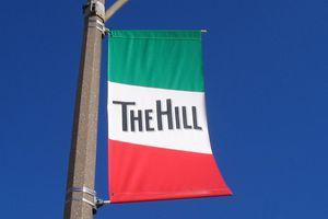 A sign welcoming visitors to The Hill in St. Louis