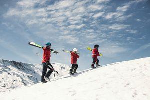 Family walking up a ski slope