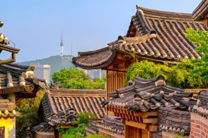 Bukchon Hanok Village with modern building in Seoul, South Korea