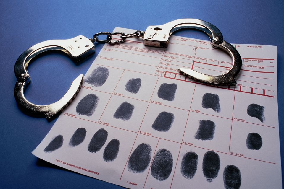 Handcuffs and fingerprint sheet