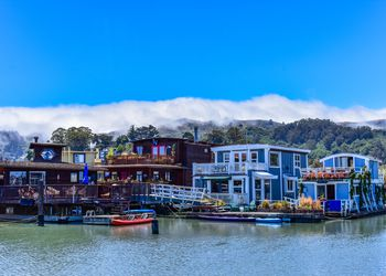 Colorful houseboats floating on the water in Sausalito, Marin County.