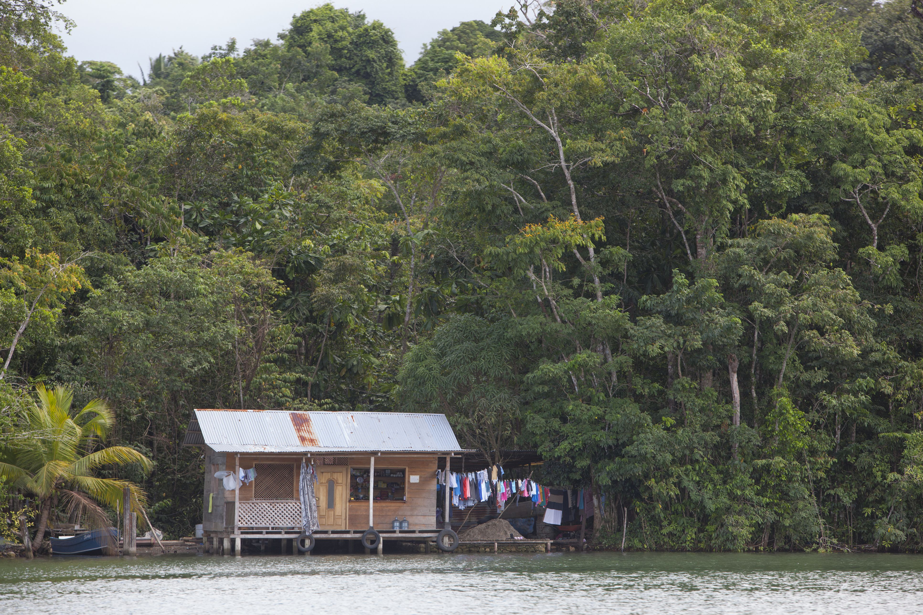 Small wooden houses on the Rio Dulce