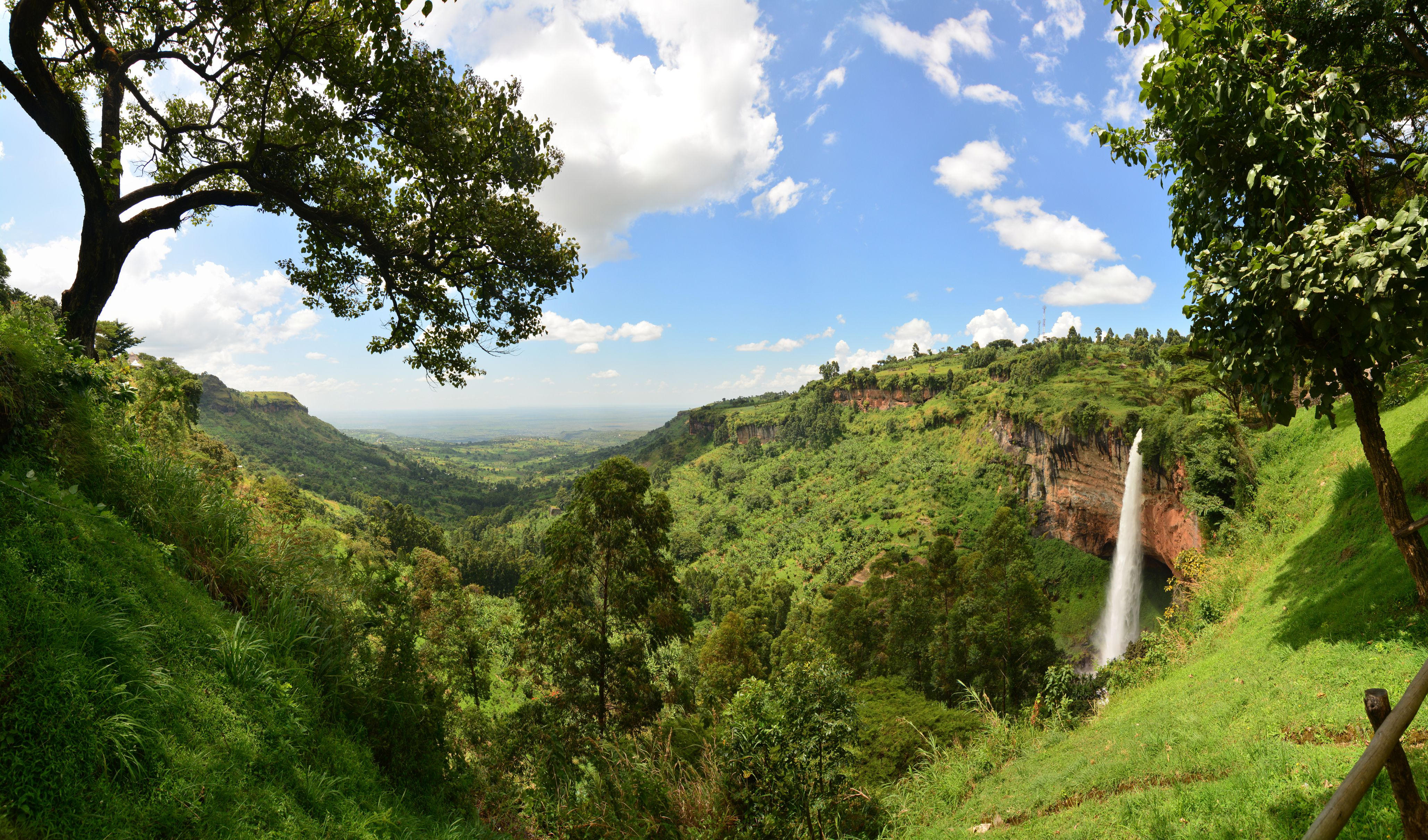 The lower Sipi waterfall, surrounded by lush rainforest vegetation