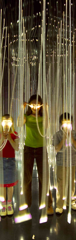 Children learning through interactive fibre-optic exhibit inside the @Bristol science centre, Bristol, Bristol, England.