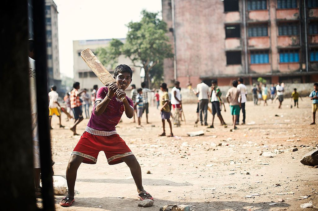 Children playing cricket in Dharavi.