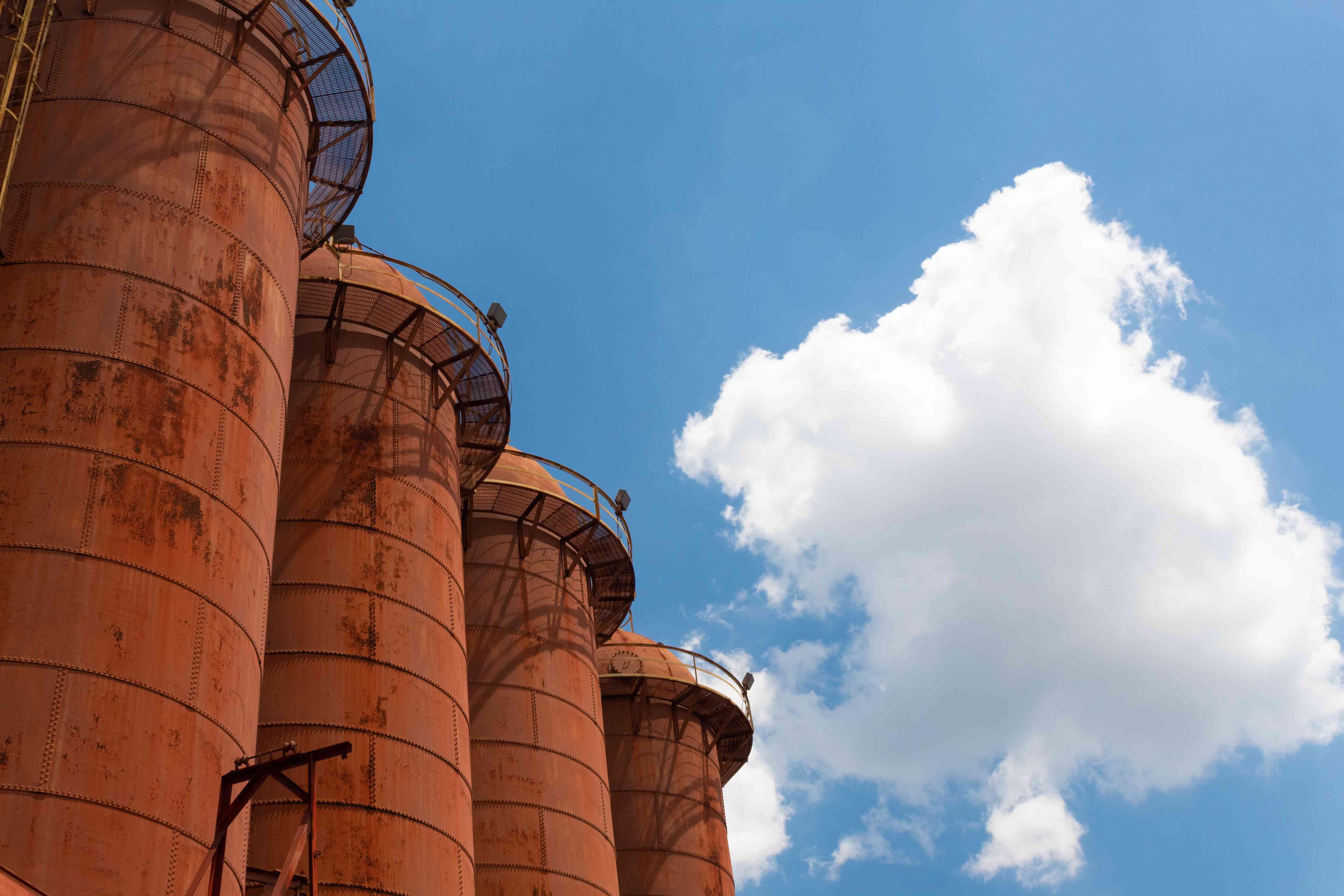 Sloss Furnaces National Historic Landmark, Birmingham Alabama USA, row of rusting blast furnaces against a brilliant blue sky with clouds, creative copy space