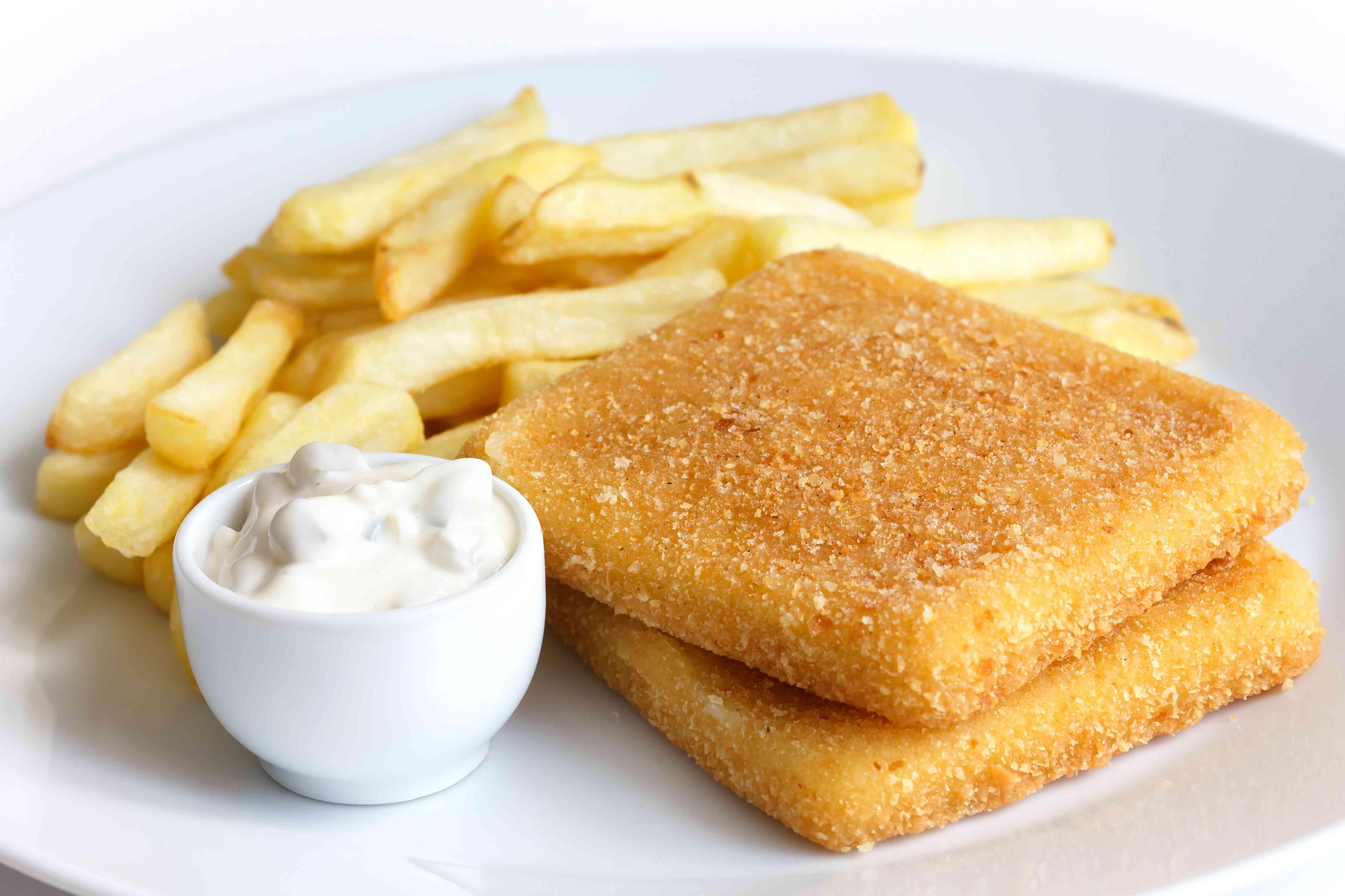 Plate of golden fried cheese, chips, tartar sauce.