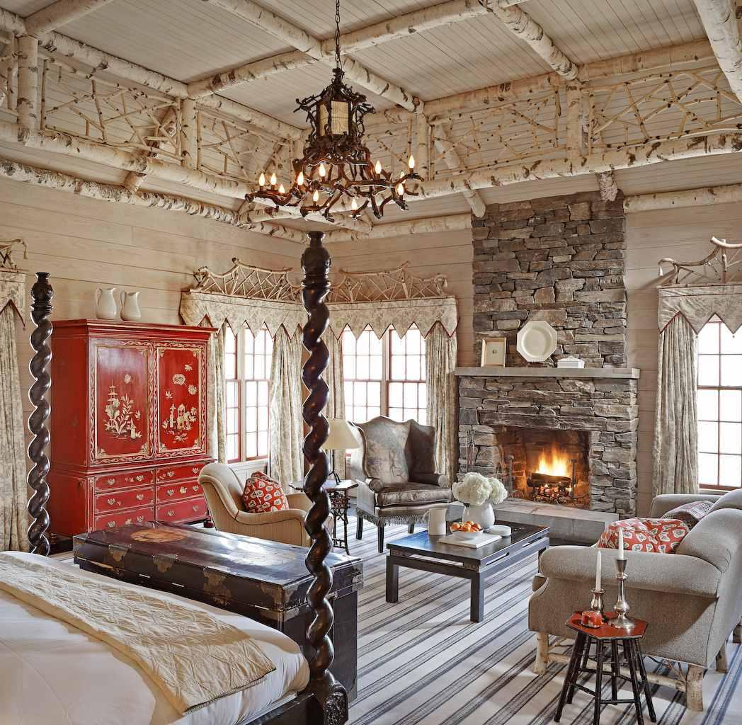 Acogedor junto al fuego en una habitación romántica de hotel en Twin Farms en Vermont