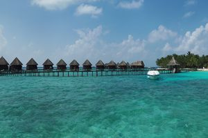 Elevated Walkway And Overwater Bungalows On Maldivian Island