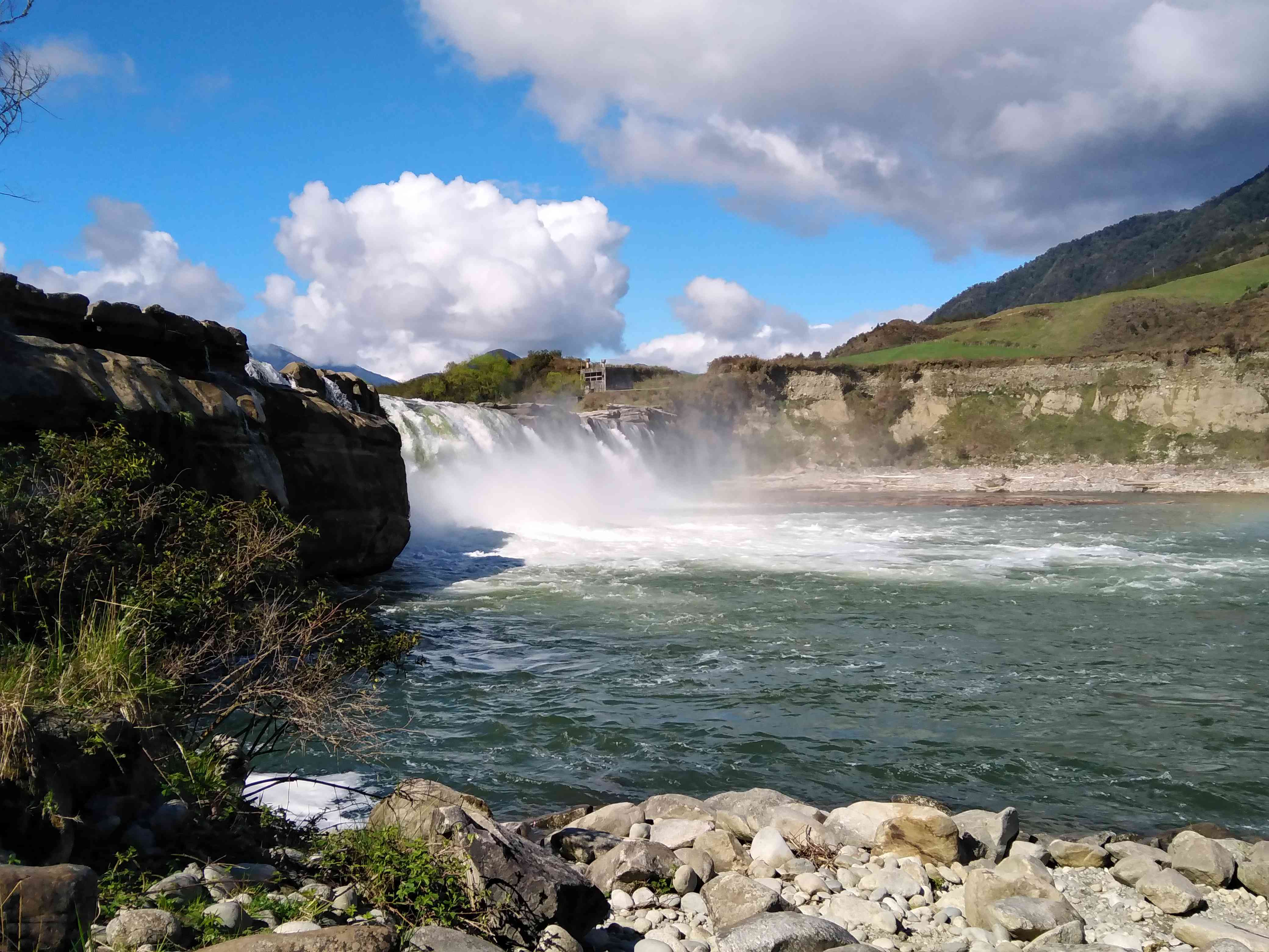 Maruia Falls with clouds, rocks, and cliffs