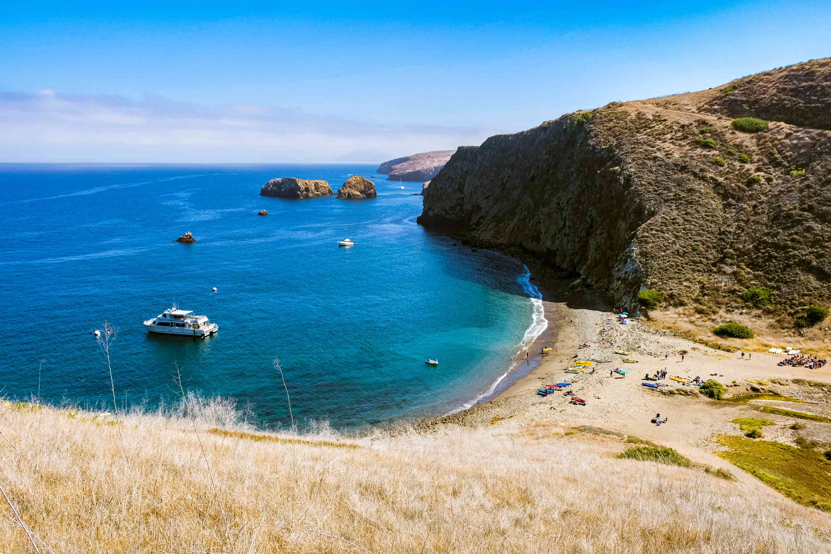 A boat leaving a beach on the Channel Islands