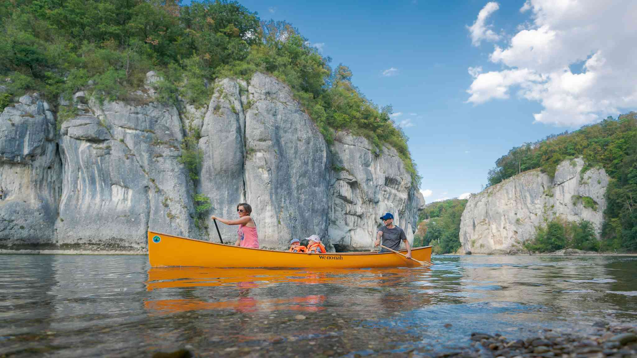 a family canoeing on the river in Altmühlthal Nature Park