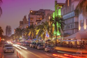 Cars driving in street at night, Miami Beach, Florida, United States