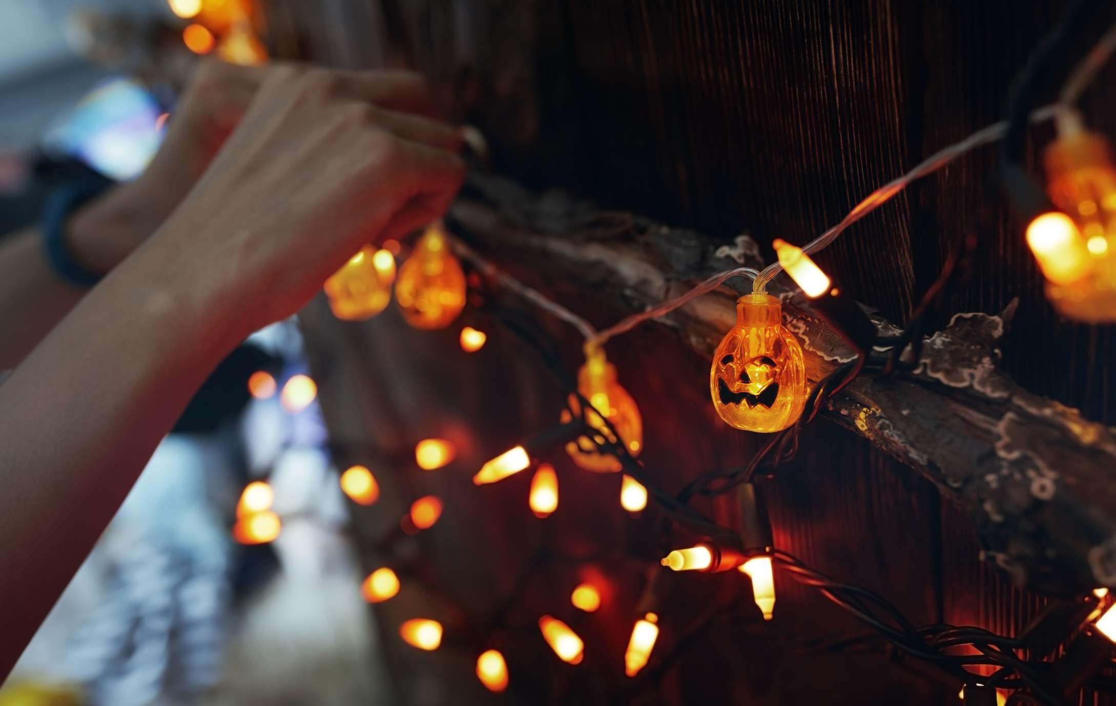 Person hanging Halloween lights