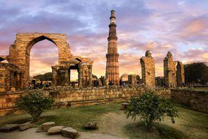 View of Qutub Minar and the Ruins of Qubbat-ul-Islam (Dome of Islam) Mosque in Qutb Complex, Mehrauli, Delhi, India