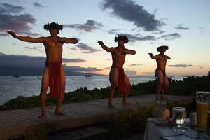 Performers dance at sunset at The Feast at Lele restaurant
