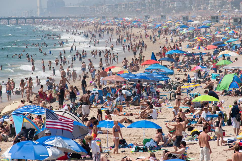 People sunbathing at Hermosa Beach on July 4