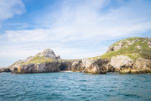 view of the rocky shore of Las Marietas Islands National Park at Pacific Ocean coast