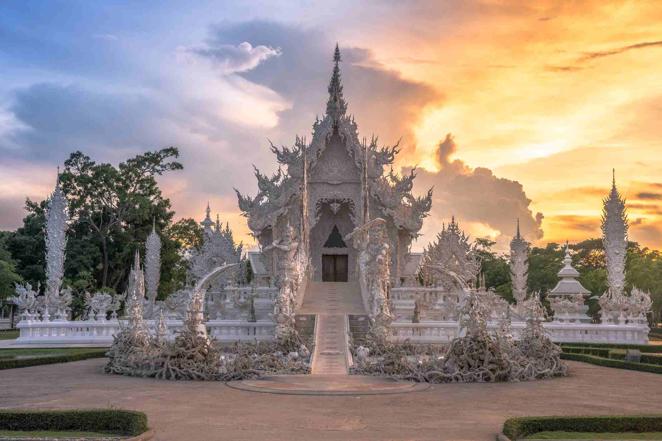 White temple with the beautiful sunset in Chiang Rai