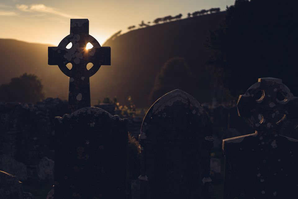 sunlight through a cross in ireland, a cross is the symbol marked on foreheads on Ash Wednesday