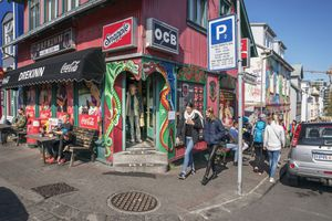 People walking past a store front, Reykjavik, Iceland