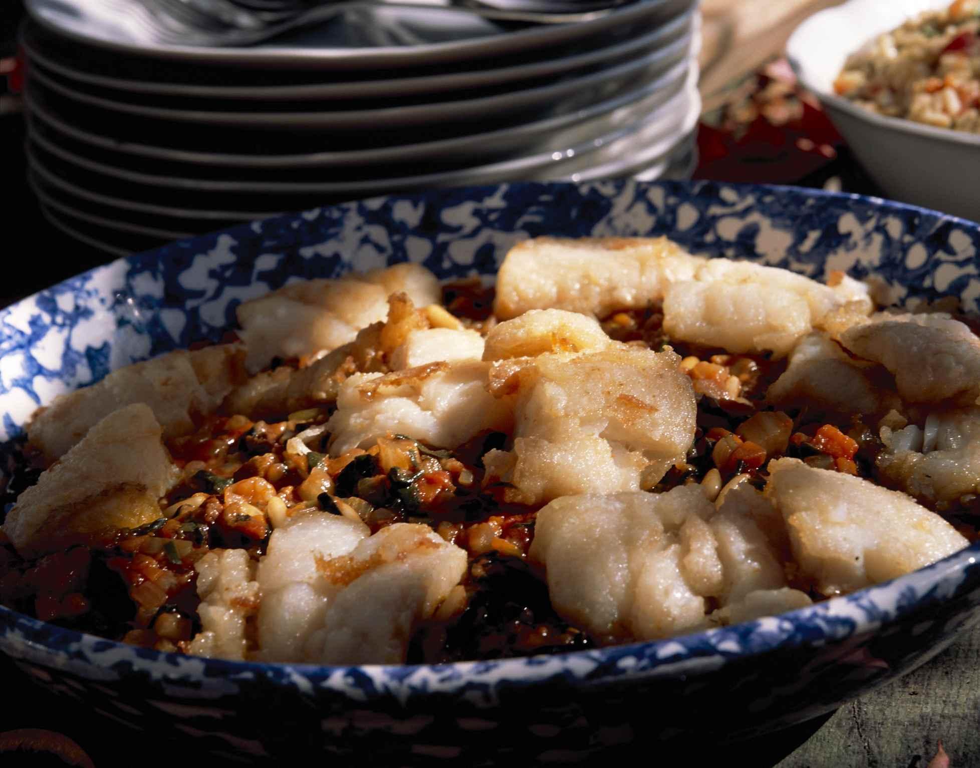 Salt cod with raisin and pine nut sauce