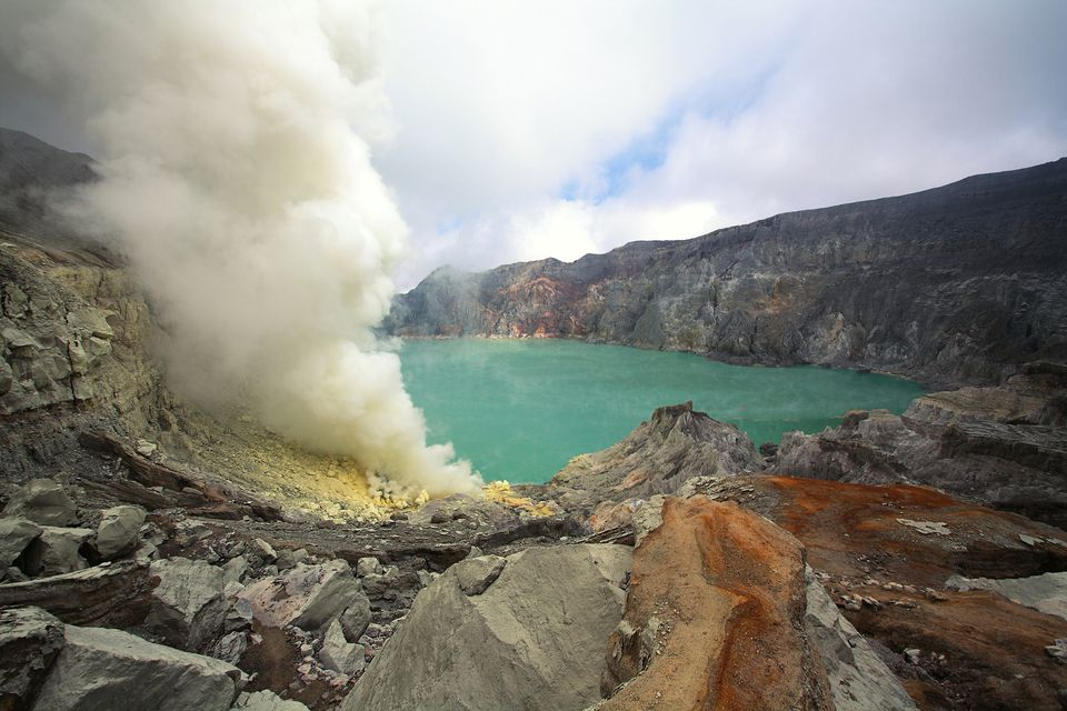 Kawah Ijen's smoking fumaroles and crater lake