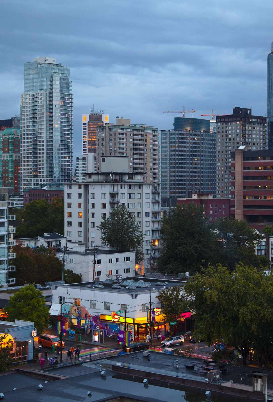 View of Vancouver at dusk, Davie Street on the foreground.