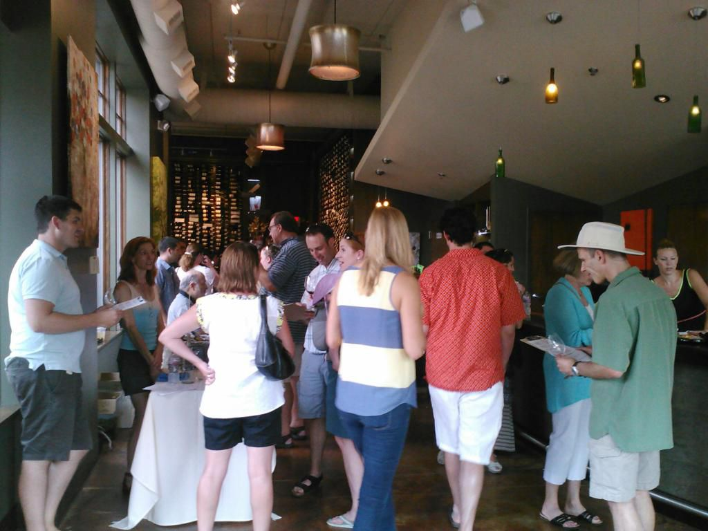 Customers walking around the Thief Wine Shop & Bar