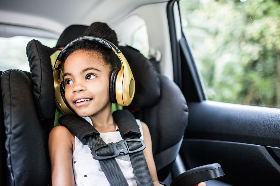 Girl (6yrs) wearing headphones in car